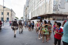 People are going to celebrate Carnival in Salvador Bahia, Brazil. Salvador Bahia, Brazil - February 11th, 2018: People are waitiing on the long line to take the Royalty Free Stock Photography