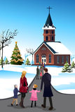 People Going to  Church. A vector illustration of people going to church to celebrate Christmas Stock Photos