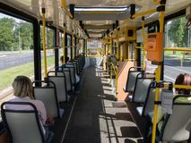 People going to destinations by tram in the city. One of sunny summer day stock images