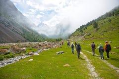 People going to mountains. People  going  to mountains sky, mountains, people, clouds Royalty Free Stock Photography