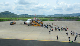 People going to the plane at the airport in Haiphong, Vietnam Royalty Free Stock Images