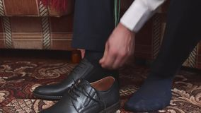 People going to work, man tying laces on black leather shoes. stock video
