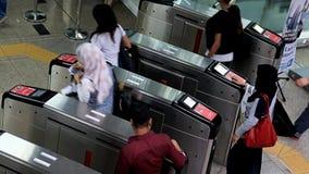 People going through the turnstile in the subway. Kuala Lumpur, Malaysia stock footage