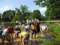 People gold panning Royalty Free Stock Image