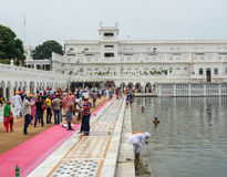 People at Golden Temple in Amritsar, India. People bathing on the lake at Golden Temple in Amritsar, India. Amritsar (also called Ambarsar) is a city in the stock images