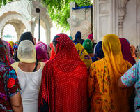 People at Golden Temple in Amritsar, India. Indian women at Golden Temple in Amritsar, India. Amritsar (also called Ambarsar) is a city in the northwestern royalty free stock image