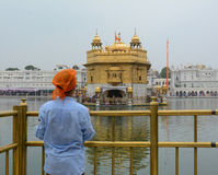 People at Golden Temple in Amritsar, India. A young man visit Golden Temple in Amritsar, India. Amritsar (also called Ambarsar) is a city in the northwestern stock photography