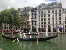 People at gondolas rowing down the Saint-Martin Canal. Royalty Free Stock Images