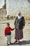 Poor people in a village from Turkey. Poor people. Grandma and grandson on a street in a village from Turkey Royalty Free Stock Photography