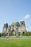 People on the grass before the Berlin cathedral Royalty Free Stock Photo