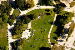 People on grass - bird eye view. People on grass viewed from the Eiffel tower in Paris royalty free stock photos
