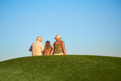 People, grass and sky. Stock Photography