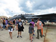 People and Gray F15 Eagle Jet Fighter Royalty Free Stock Photo