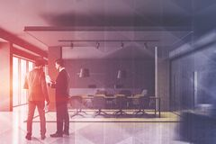 People in gray meeting room interior stock photography