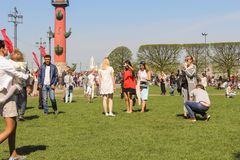 People on the green lawn. Royalty Free Stock Photo