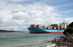 People greet a huge cargo ship Maersk Line entering to Pilot ba. Mount Maunganui, Tauranga, New Zealand - October 4, 2016: People greet a huge cargo ship Maersk Stock Images