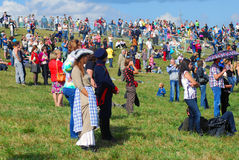 People greet participants of Borodino battle historical reenactment in Moscow region. Royalty Free Stock Photo