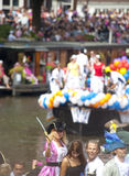 People greeting from a boat at Canal Parade Stock Photo
