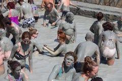 People in grey mud bath. Dalyan, Turkey Stock Photos