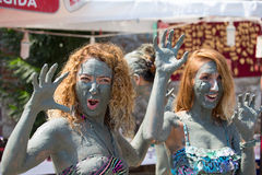 People in grey mud bath. Dalyan, Turkey Royalty Free Stock Image