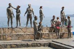 People in grey mud bath. Dalyan, Turkey Royalty Free Stock Photos