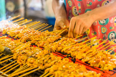 People grilled pork satays on the stove oven thai style Royalty Free Stock Image
