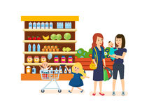 People at grocery store, purchased merchandise and walk through mall. Family shopping in supermarket. Girl with a basket full of products is walking through the Royalty Free Stock Image