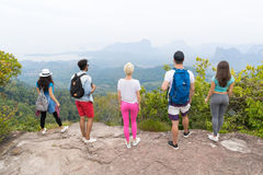 People Group With Backpacks Standing On Mountain Top Enjoy Landscape Back Rear View, Young Men And Woman. Backpackers On Hike stock images