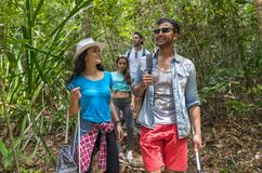 People Group With Backpacks Trekking On Forest Path, Mix Race Young Men And Woman On Hike Tourists Royalty Free Stock Photography