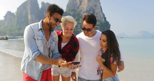 People Group On Beach Taking Selfie Photo On Cell Smart Phone Happy Men And Women Tourists On Vacation. Slow Motion 60 stock video footage