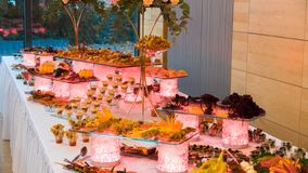 People group catering buffet food indoor in luxury restaurant with meat.  royalty free stock photo