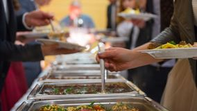 People group catering buffet food indoor in luxury restaurant with meat.  stock image