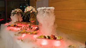 People group catering buffet food indoor in luxury restaurant with meat.  stock photo