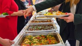 People group catering buffet food indoor in luxury restaurant with meat.  royalty free stock images