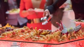 People group catering buffet food indoor in luxury restaurant with meat.  royalty free stock photography
