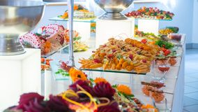 People group catering buffet food indoor in luxury restaurant. With meat colorful fruits and vegetables stock images