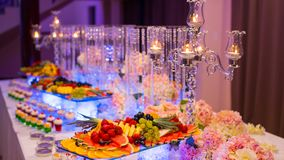 Catering buffet food indoor in luxury restaurant. People group catering buffet food indoor in luxury restaurant with meat colorful fruits and vegetables royalty free stock photos