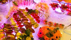 Catering buffet food indoor in luxury restaurant. People group catering buffet food indoor in luxury restaurant with meat colorful fruits and vegetables stock photography