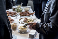 People group catering buffet food indoor luxury restaurant with meat and salad royalty free stock photos