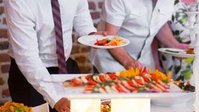People group catering buffet food indoor in luxury restaurant. With meat colorful fruits and vegetables stock image