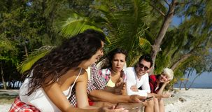 People Group Communication Using Cell Smart Phones Chatting Online Talking, Sit Outdoors Under Palm Trees stock video