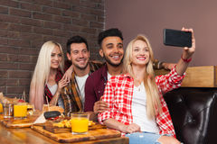 People Group Eating Fast Food Burgers Potato Sitting At Wooden Table In Cafe Taking Selfie Photo Royalty Free Stock Images