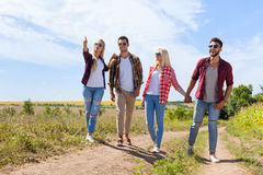 People group friends walking countryside road two couple happy smile royalty free stock photo
