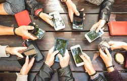 People group having addicted fun together using smartphones - De. Tail of hands sharing content on social network with mobile smart phones - Millennials online Stock Image