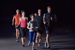 People group jogging at night Royalty Free Stock Photos
