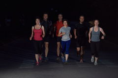 People group jogging at night Stock Photography