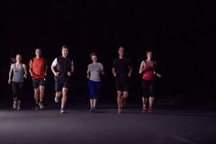 People group jogging at night Royalty Free Stock Images
