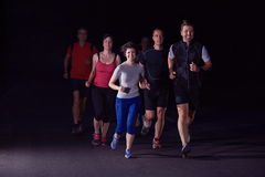People group jogging at night Stock Image