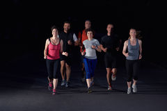People group jogging at night Stock Photos