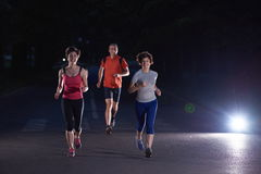 People group jogging at night Royalty Free Stock Photography